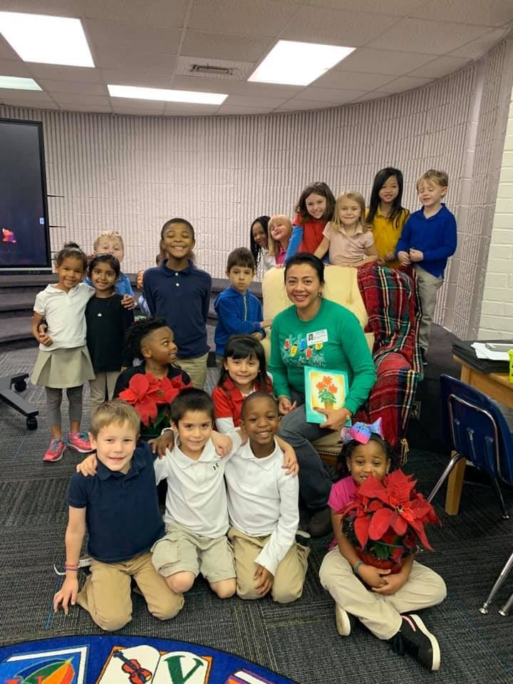 Mrs. Galloway read The Legend of the Poinsettia to Ms. Henderson's CREW
