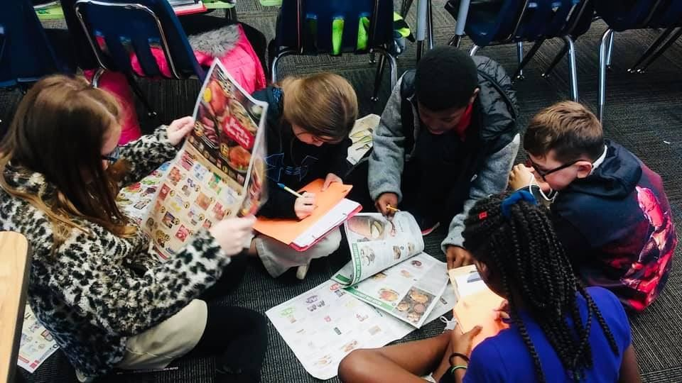 Ms. Owens' CREW planning a Thanksgiving dinner using a budget and newspaper ads