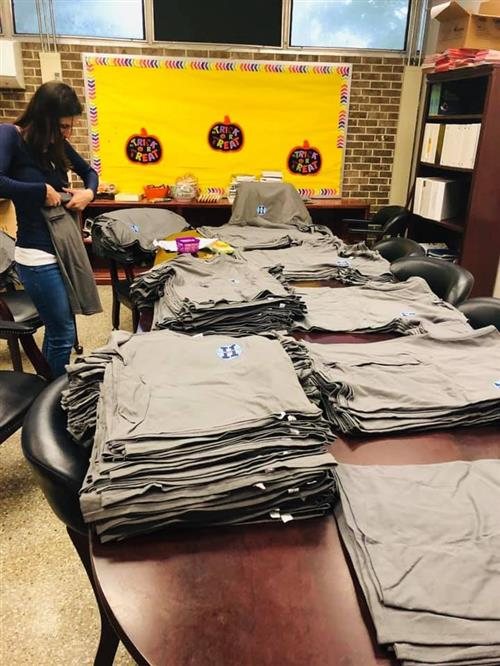 Thankful for our PTO! helping to organize T-shirts