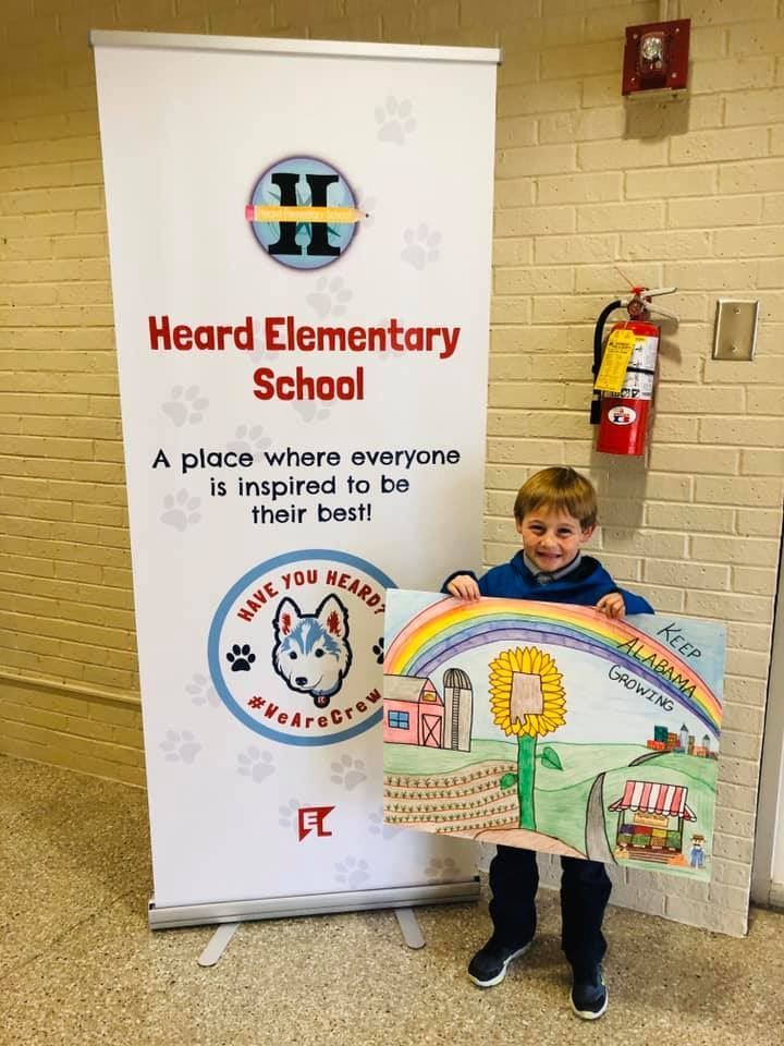 Sam Thornton represents Heard Elementary in the Farm City Poster Contest