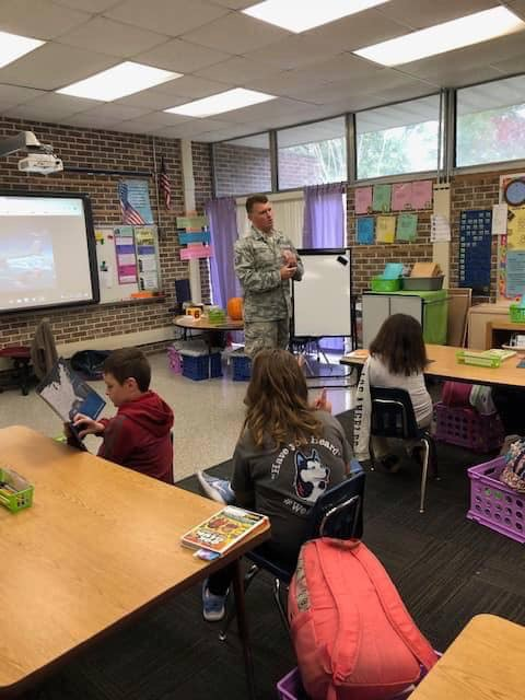 Mr. Turley sharing his experiences in the Air Force with Mrs. Lee's third grade class for Veteran's Day