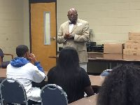 Mr. Faulk speaking with students